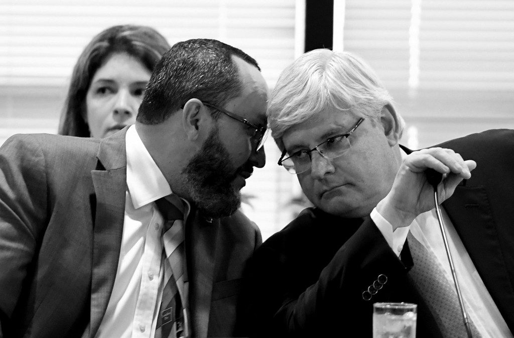 Brazil's Attorney General Rodrigo Janot(R) listens to Attorney General Office' Secretary of International Cooperation Vladimir Aras during a meeting with ten Latin American countries at the Attorney General's Office in Brasilia, on February 16, 2017.  Prosecutors from countries caught up in the gigantic bribery scandal at Brazilian construction conglomerate Odebrecht hold a conference.  / AFP / EVARISTO SA        (Photo credit should read EVARISTO SA/AFP via Getty Images)