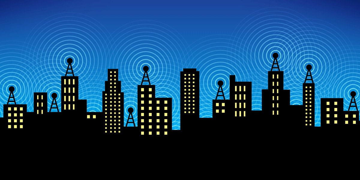 A city skyline, with overlapping wifi signals in the night sky.