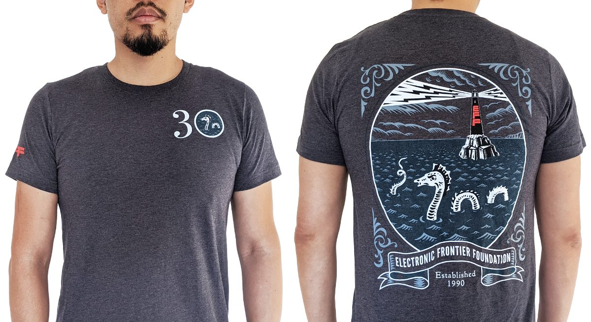 Blue t-shirt with EFF30 on the front and lighthouse and sea monster on the back