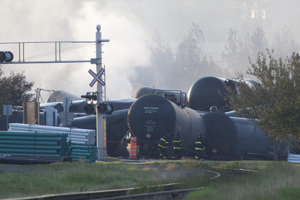 Firefighters inspect the wreckage on July 7, 2013 of a freight train loaded with oil that derailed July 6 in Lac-Megantic in Canada's Quebec province, sparking explosions that engulfed about 30 buildings in a wall of fire.
