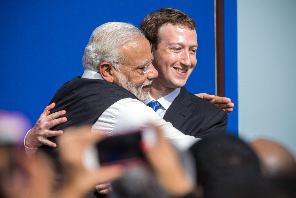 Narendra Modi, India's prime minister, left, and Mark Zuckerberg, chief executive officer of Facebook Inc., embrace at the conclusion of a town hall meeting at Facebook headquarters in Menlo Park, California, U.S., on Sunday, Sept. 27, 2015. Prime Minister Modi plans on connecting 600,000 villages across India using fiber optic cable as part of his