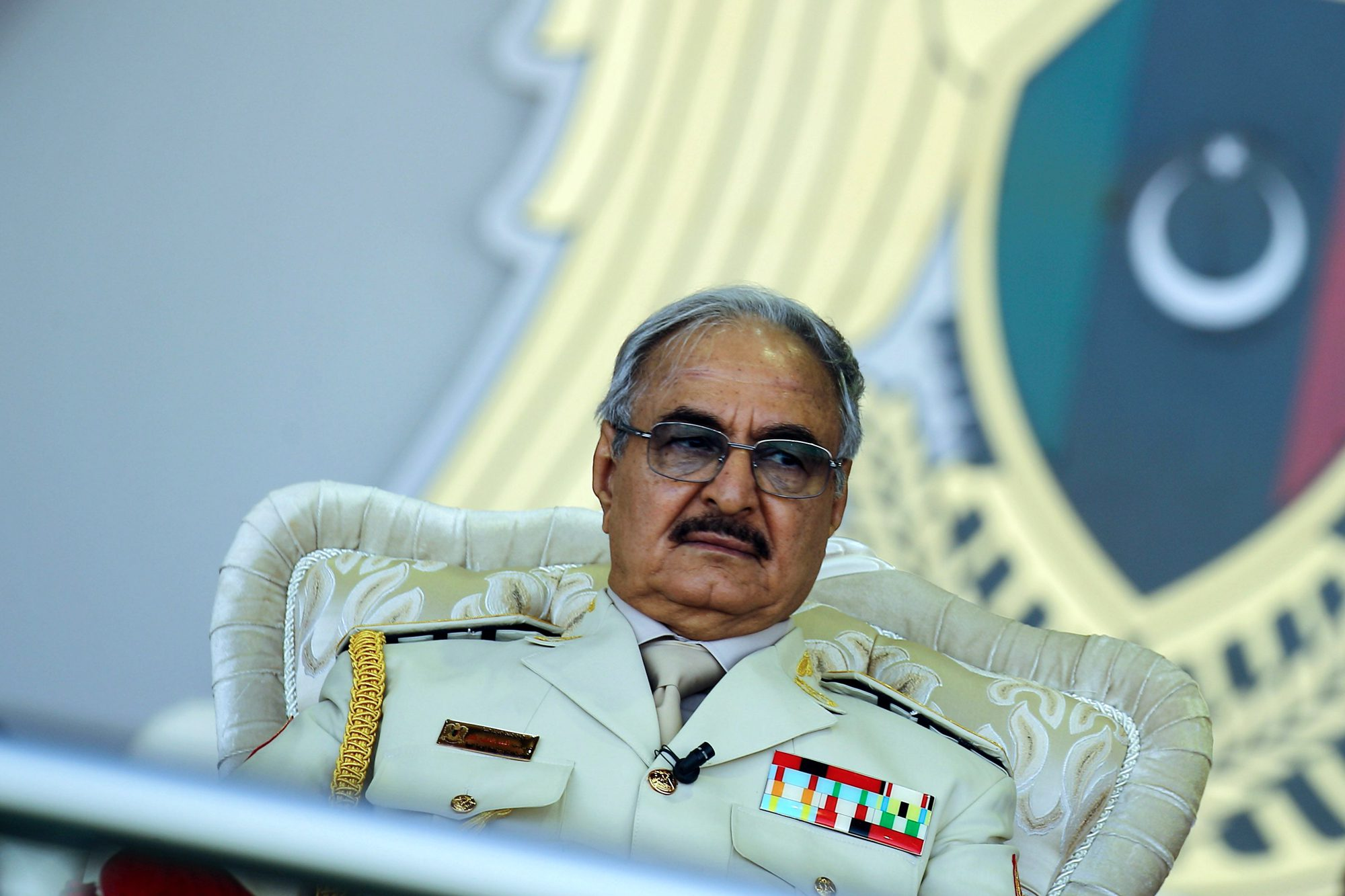 Libyan Strongman Khalifa Haftar attends a military parade in the eastern city of Benghazi on May 7, 2018.