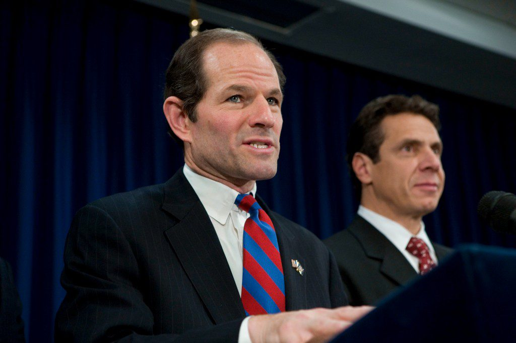 New York State Governor Eliot Spitzer speaks as Andrew Cuomo, New York State Attorney General looks on during a news conference to introduce initiatives to address irresponsible home lending practices in New York. (Photo by Ramin Talaie/Corbis via Getty Images)