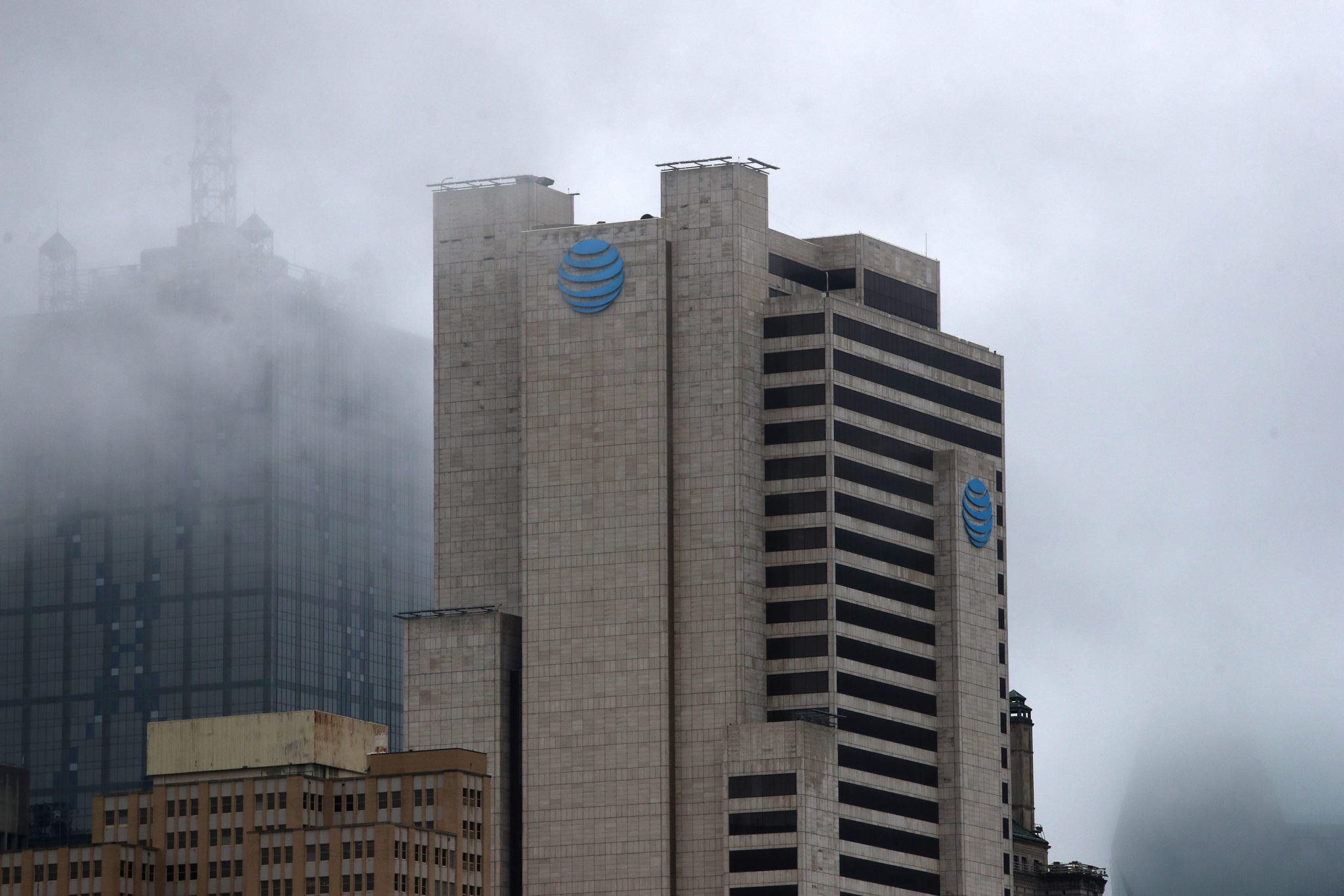 DALLAS, TEXAS - MARCH 13:  An exterior view of AT&T corporate headquarters on March 13, 2020 in Dallas, Texas.  AT&T is allowing employees to work remotely from home if they have the ability to do so, as a safety measure due to COVID-19. (Photo by Ronald Martinez/Getty Images)