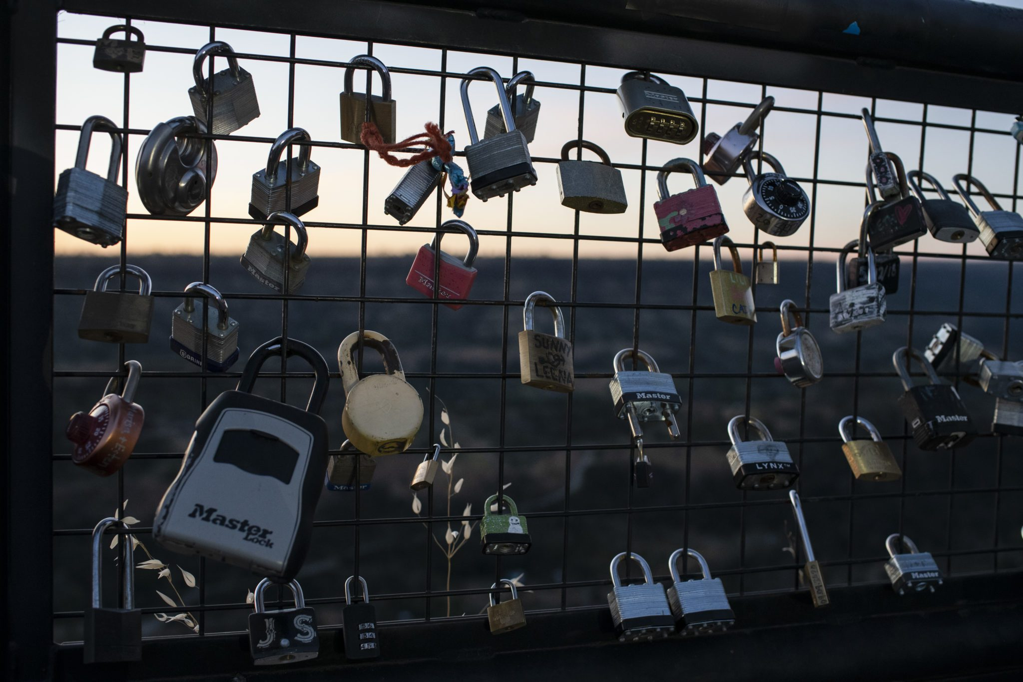 Locks line the fence at Lookout Point on the Skyway overlooking Butte Creek Canyon just outside Chico, Calif. on Tuesday May 4, 2021  Many people placed locks here in memory of people who died in the Camp Fire.  Salgu Wissmath for The Intercept