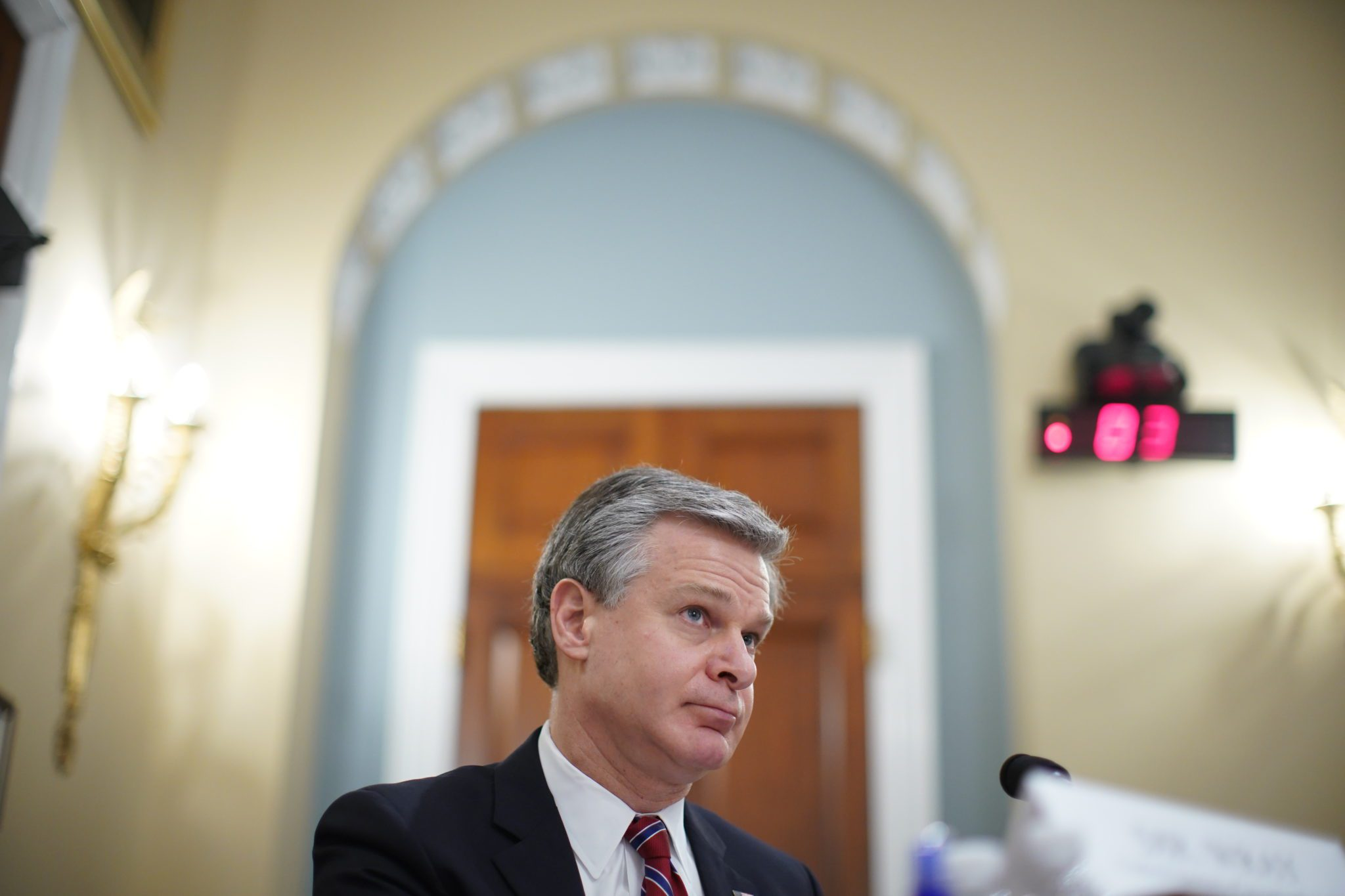 Christopher Wray, director of the Federal Bureau of Investigation (FBI), pauses during a House Intelligence Committee hearing in Washington, D.C., U.S., on Thursday, April 15, 2021. The hearing follows the release of an unclassified report by the intelligence community detailing the U.S. and its allies will face