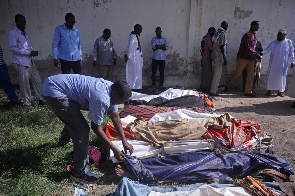 Relatives gather to look at the dead bodies of ten people including children after a raid on their farms in Bariire, some 50 km west of Mogadishu, on August 25, 2017.Somali officials said Friday they had killed eight jihadist fighters during an overnight operation, denying claims from local elders that they had shot civilians dead, two of them children. Somali community leaders accused the troops, accompanied by US military advisors, of having killed the nine civilians in the overnight operations. An initial government statement said its troops had come under fire from jihadists while on patrol, insisting that no civilians had been killed. A later statement acknowledged that there had been civilian casualties, in what the government seemed to suggest was a separate incident. They did not say who was responsible. / AFP PHOTO / Mohamed ABDIWAHAB (Photo credit should read MOHAMED ABDIWAHAB/AFP via Getty Images)