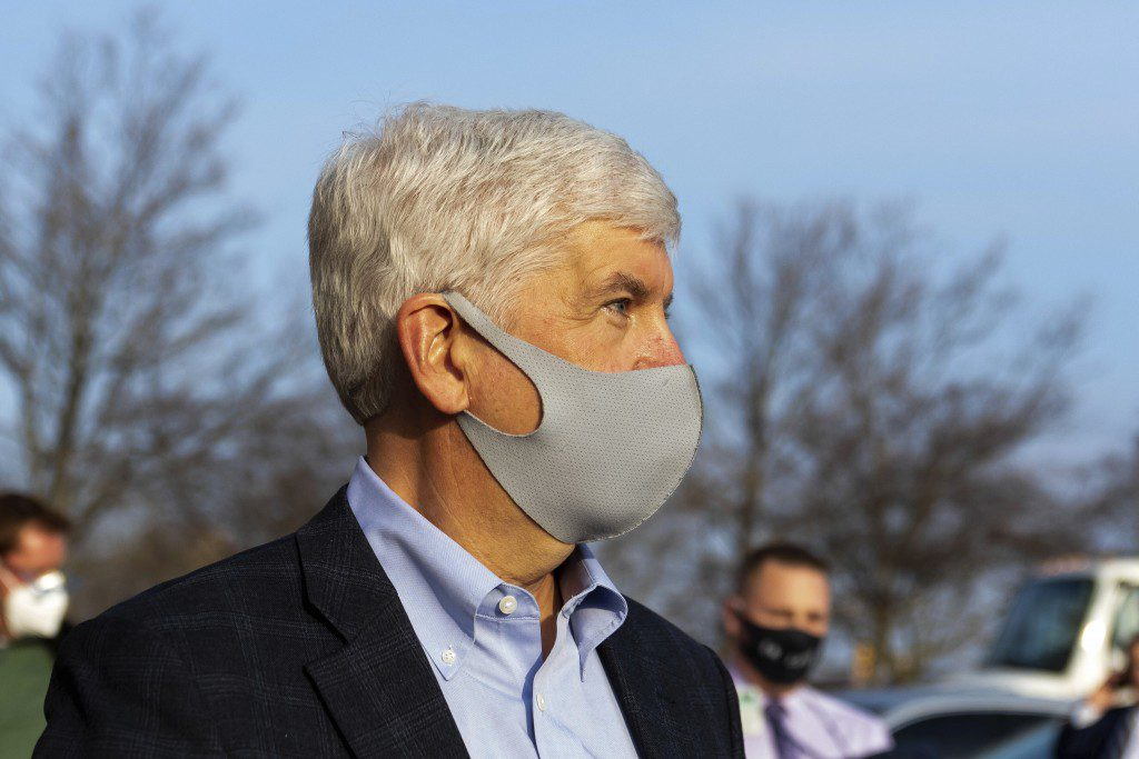 Former Gov. Rick Snyder stays silent as barrage of media asks questions after his video arraignment on charges related to the Flint water crisis, Thursday, Jan. 14, 2021 outside the Genesee County Jail in downtown Flint, Mich. (Cody Scanlan/The Flint Journal via AP)