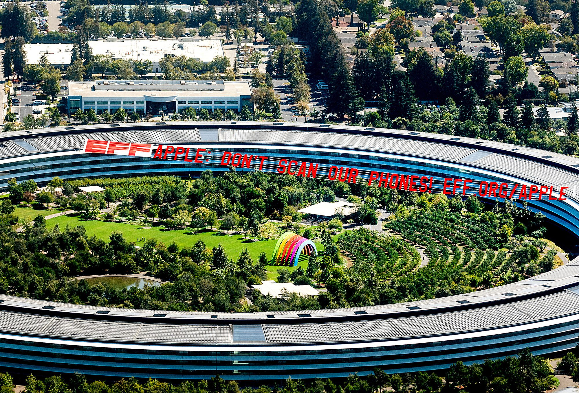 A plane flies over Apple's HQ with a banner
